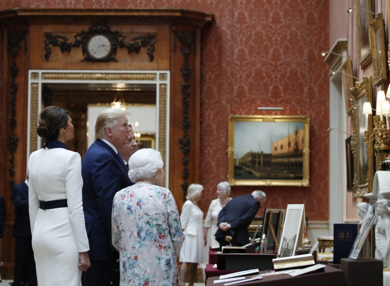 President Donald Trump, first lady Melania Trump and Queen Elizabeth II, walk in the Picture Gallery at Buckingham Palace, Monday, June 3, 2019, in London. (AP Photo/Alex Brandon)