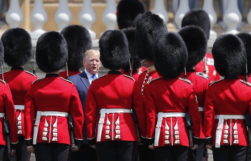 President Donald Trump reviews an honor guard during a ceremonial welcome in the garden of Buckingham Palace in London, Monday, June 3, 2019 on the opening day of a three day state visit to Britain. (AP Photo/Frank Augstein)