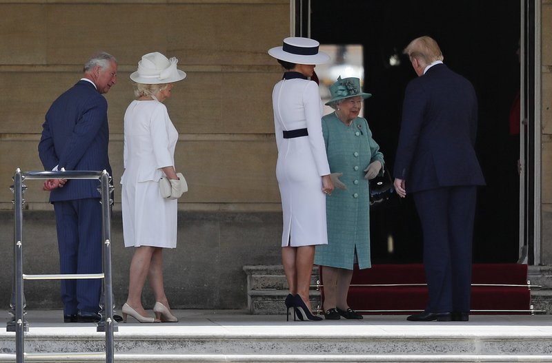 Britain's Queen Elizabeth II greets President Donald Trump, right, and first lady Melania Trump with Britain's Prince Charles, left, and Camilla, Duchess of Cornwall during a ceremonial welcome in the garden of Buckingham Palace in London, Monday, June 3, 2019 on the opening day of a three day state visit to Britain. (AP Photo/Frank Augstein)
