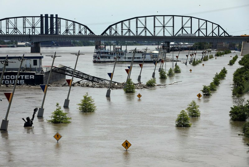 Water from the Mississippi River floods Leonor K. Sullivan Boulevard, Saturday, June 1, 2019, in St. Louis. The Mississippi River is expected to rise several more feet by midweek. (David Carson/St. Louis Post-Dispatch via AP)