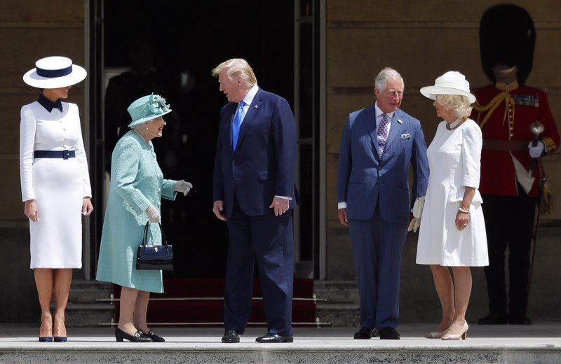 Britain's Queen Elizabeth II greets President Donald Trump, center, and first lady Melania Trump, left, with Britain's Prince Charles and Camilla, Duchess of Cornwall during a ceremonial welcome in the garden of Buckingham Palace in London, Monday, June 3, 2019 on the opening day of a three day state visit to Britain. (AP Photo/Frank Augstein)