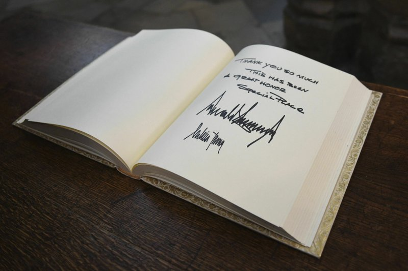 The visitors books signed by US President Donald Trump and his wife Melania after their tour of Westminster Abbey in central London, Monday, June 3, 2019. Trump is on a three-day state visit to Britain. (Stefan Rousseau/Pool Photo via AP)