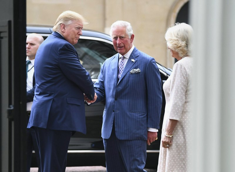 US President Donald Trump, left,  is greeted by Britain's Prince Charles and Camilla, the Duchess of Cornwall prior to afternoon tea at Clarence House, in London, Monday, June 3, 2019. Trump is on a three-day state visit to Britain. (Victoria Jones/Pool Photo via AP)