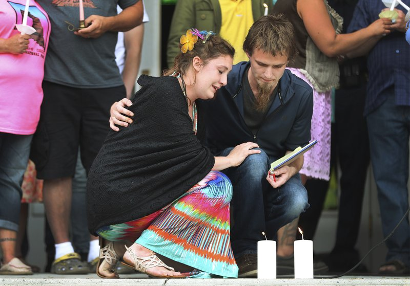 In a Saturday, June 1, 2019 photo, Jessica Whipple is comforted by her fiancée Detrich Black during a candlelight vigil in remembrance of her daughter Elizabeth