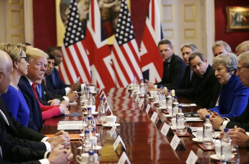 U.S President Donald Trump, center left, and British Prime Minister Theresa May, center right, attend a business roundtable event at St. James's Palace, London, Tuesday June 4, 2019. (AP Photo/Tim Ireland)