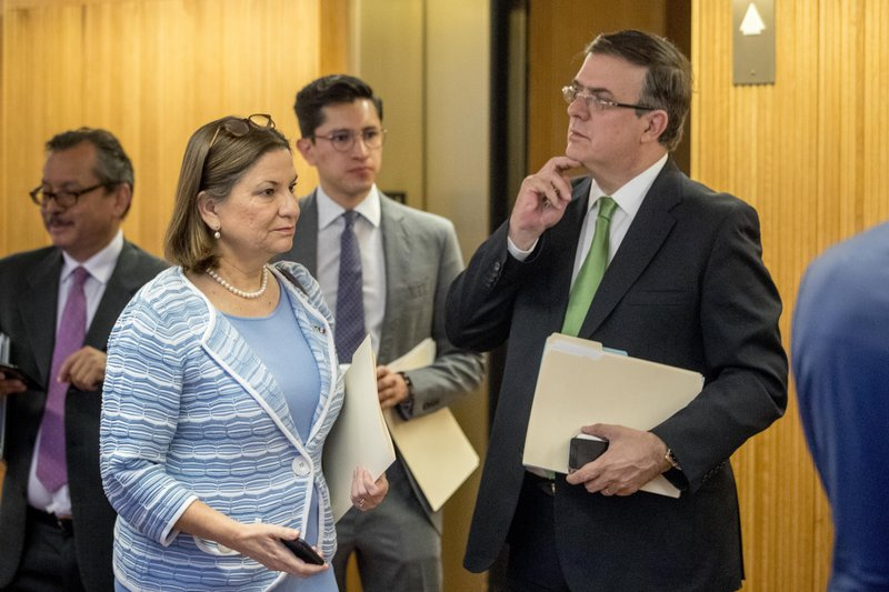 Mexican Ambassador Martha Barcena Coqui, second from left, and Mexican Foreign Affairs Secretary Marcelo Ebrard, right, speak before a news conference at the Mexican Embassy in Washington, Tuesday, June 4, 2019, as part of a Mexican delegation in Washington for talks following trade tariff threats from the Trump Administration. (AP Photo/Andrew Harnik)