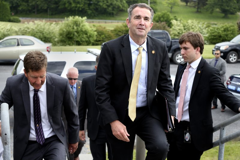 Virginia Gov. Ralph Northam arrives at Virginia Tech's Alson H. Smith Jr. Agricultural Research and Extension Center in Frederick County, Va., for a tour of the facility, Thursday, May 23, 2019. The mystery of whether Northam was in the racist yearbook photo that upended Virginia politics may never be solved, but one thing is clear: The governor has survived what many initially thought was a fatal blow and has managed to return to something resembling normal. (Jeff Taylor/The Winchester Star via AP)