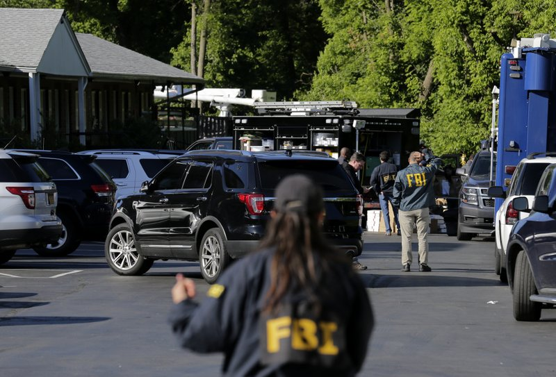 Investigators work on the scene of a drug bust at the Ardsley Acres motel in Ardsley, N.Y., Tuesday, June 4, 2019. New York authorities say a suspect in a drug bust was killed and two police officers were injured during a shootout Monday night at the motel in Westchester County. (AP Photo/Seth Wenig)