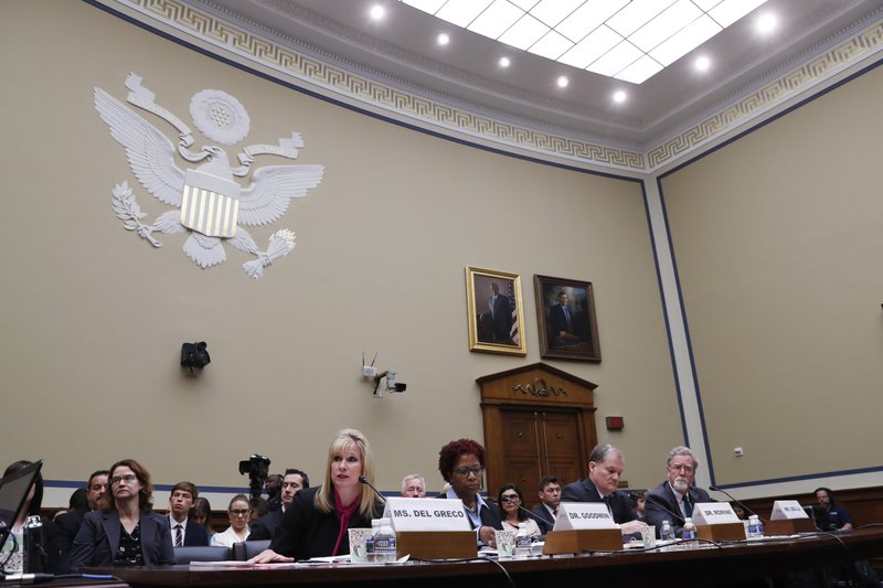 Kimberly Del Greco, FBI Deputy Assistant Director of Criminal Justice Information Services, left, Gretta Goodwin, Director of Homeland Security and Justice for the Government Accountability Office, Charles Romine, Director of the Information Technology Laboratory at the National Institute of Standards and Technology, and Austin Gould, Assistant Administrator of Requirements and Capabilities Analysis at the Transportation Security Administration (TSA), attend a House Oversight and Reform committee hearing on facial recognition technology in government, Tuesday June 4, 2019, on Capitol Hill in Washington. (AP Photo/Jacquelyn Martin)