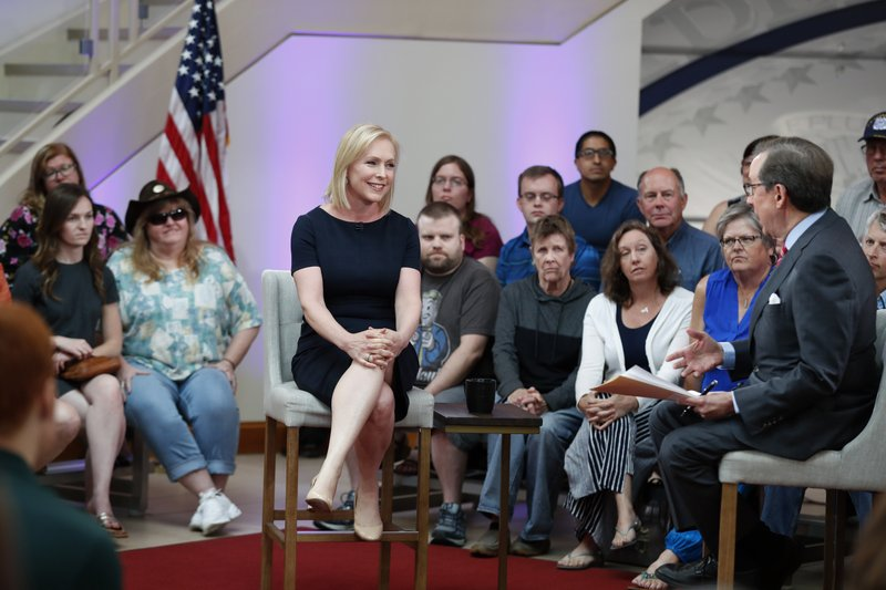 Democratic presidential candidate Sen. Kirsten Gillibrand talks with FOX News Anchor Chris Wallace, right, during a FOX News town hall, Sunday, June 2, 2019, in Dubuque, Iowa. (AP Photo/Charlie Neibergall)
