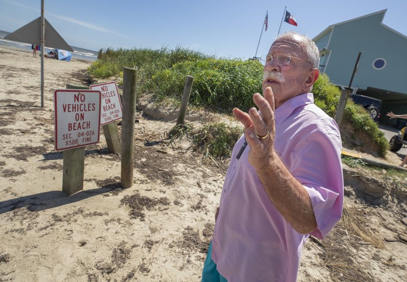 In this June 3, 2019, photo Lafitte's Cove resident Bill Broussard speaks Monday, June 3, 2019 at a beach access point on Pirates Drive in the Pirates Beach community on Galveston's west end in Texas. (Stuart Villanueva/The Galveston County Daily News via AP)