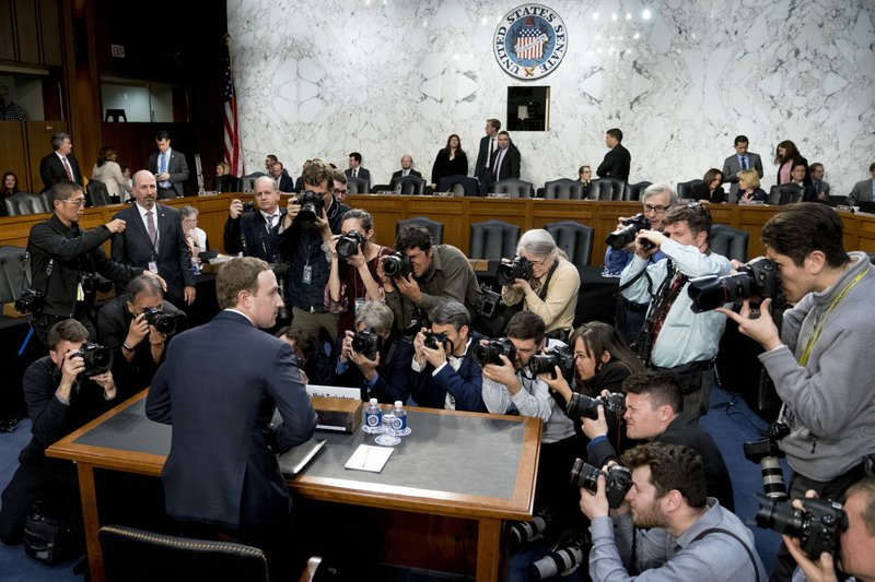 FILE - In this April 10, 2018, file photo, Facebook CEO Mark Zuckerberg returns from a break as he testifies before a joint hearing of the Commerce and Judiciary Committees on Capitol Hill in Washington. The U.S. Justice Department and the Federal Trade Commission are moving to investigate Google, Facebook, Amazon and Apple over their aggressive business practices, and the House Judiciary Committee has announced an antitrust probe of unidentified technology companies. (AP Photo/Andrew Harnik, File)