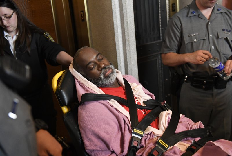 A protester who became unresponsive while being arrested by state police is helped by medical personnel as tenants and members of the Upstate Downstate Housing Alliance from across the state, demand New York Gov. Andrew Cuomo and state legislators pass universal rent control legislation that would strengthen and expand tenants rights across the state of New York before rent laws expire on June 15th during a protest rally at the state Capitol Tuesday, June 4, 2019, in Albany, N.Y. (AP Photo/Hans Pennink)\