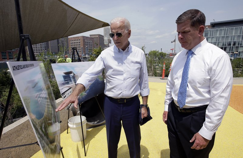 Former vice president and Democratic presidential candidate Joe Biden, left, and Boston Mayor Marty Walsh reviews renderings on Wednesday, June 5, 2019, of a park in Boston being constructed in honor of Martin Richard, the youngest victim of the 2013 Boston Marathon bombings. (AP Photo/Steven Senne)