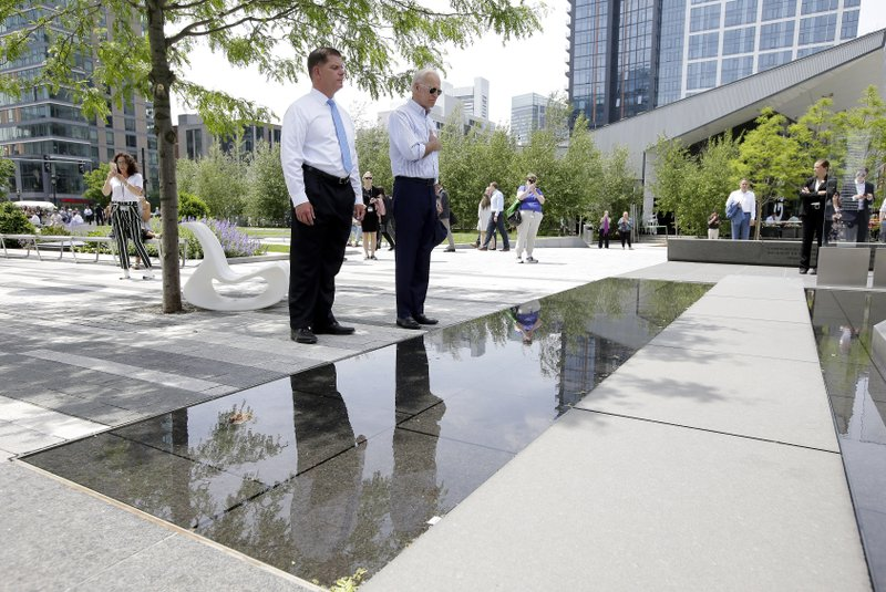 Former vice president and Democratic presidential candidate Joe Biden, right, pauses with Boston Mayor Marty Walsh, left, at a memorial to fallen servicemen on Wednesday, June 5, 2019, in Boston. (AP Photo/Steven Senne)