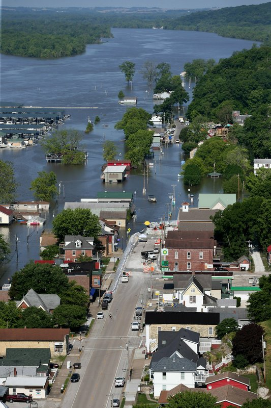 Main Street in downtown Grafton, Ill., is swamped with Mississippi River flood water during historic flooding in Grafton on Wednesday, June 5, 2019. (David Carson/St. Louis Post-Dispatch via AP)