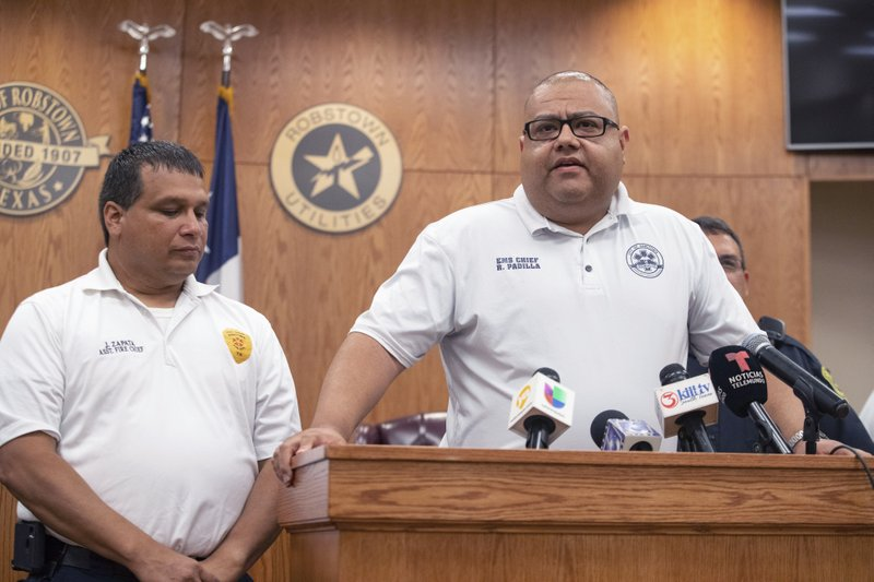 Robstown EMS Chief Roland Padilla speaks at Robstown City Hall during a press conference following a wreck early Wednesday, June 5, 2019 that left multiple migrants dead and injured and three in the custody of Border Patrol just outside of Robstown, Texas on Wednesday, June 5, 2019.   (Courtney Sacco/Corpus Christi Caller-Times via AP)