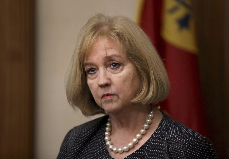 In this Sept. 19, 2017 file photo St. Louis Mayor Lyda Krewson holds a news conference at city hall in St. Louis. Police departments in at least five states are investigating, and in some cases condemning, their officers' social media feeds after the weekend publication of a database that appears to catalog thousands of bigoted or violent posts by active-duty and former cops. St. Louis began an internal affairs probe, and announced that officers will undergo sensitivity training, after researchers flagged 166 posts by active-duty police. The city prosecutor's office said Wednesday, June 5, 2019 it has launched a separate review. Krewson said in a statement