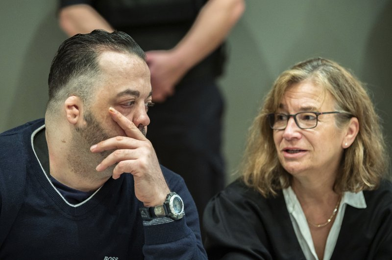 Former nurse Niels Hoegel, left, accused of multiple murder and attempted murder of patients, talks to his lawyer Ulrike Baumann, right, during a session of the district court in Oldenburg, Germany, Wednesday, June 5, 2019. (Mohssen Assanimoghaddam/dpa via AP, Pool)