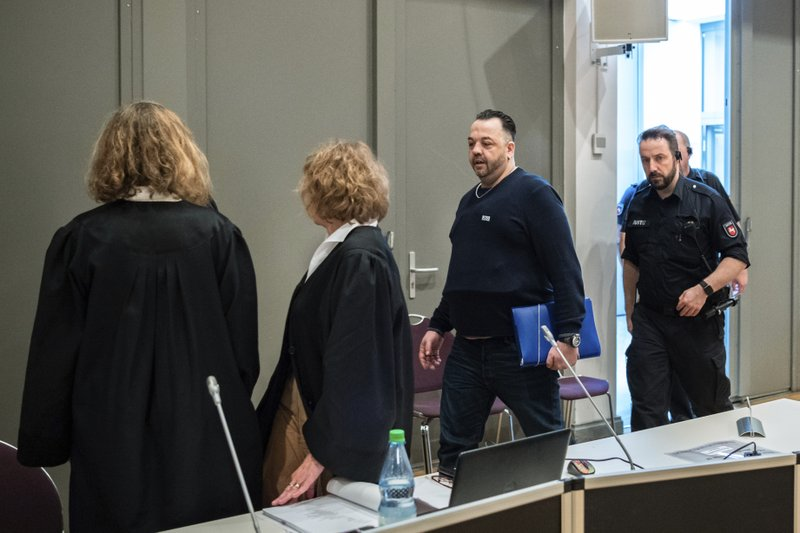 Former nurse Niels Hoegel, 3rd left, accused of multiple murder and attempted murder of patients, arrives for a session of the district court in Oldenburg, Germany, Wednesday, June 5, 2019. (Mohssen Assanimoghaddam/dpa via AP, Pool)