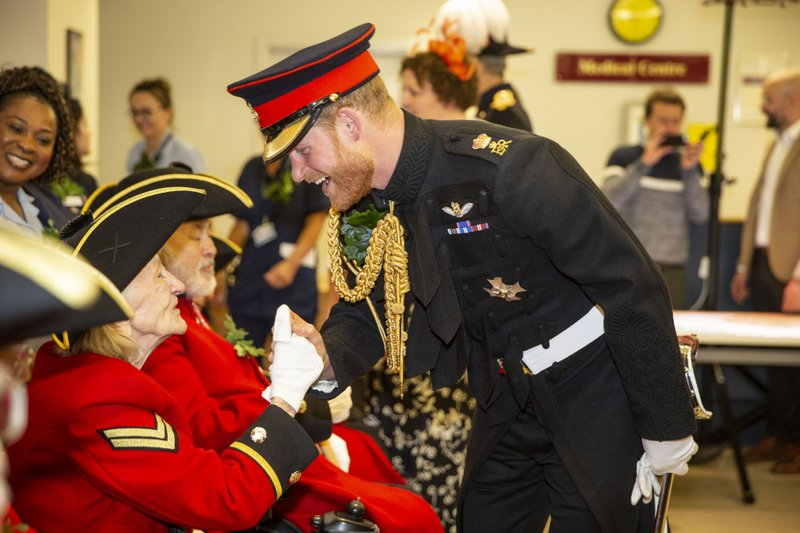 Britain's Prince Harry speaks to Chelsea Pensioners during a visit to the Margaret Thatcher Infirmary whilst attending Founder's Day at the Royal Hospital Chelsea in London, Thursday, June 6, 2019. (Heathcliff O'Malley/Pool photo via AP)