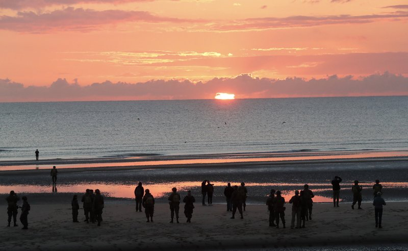World War II reenactors gather at dawn on Omaha Beach, in Normandy, France, Thursday, June 6, 2019 during commemorations of the 75th anniversary of D-Day. (AP Photo/Thibault Camus)