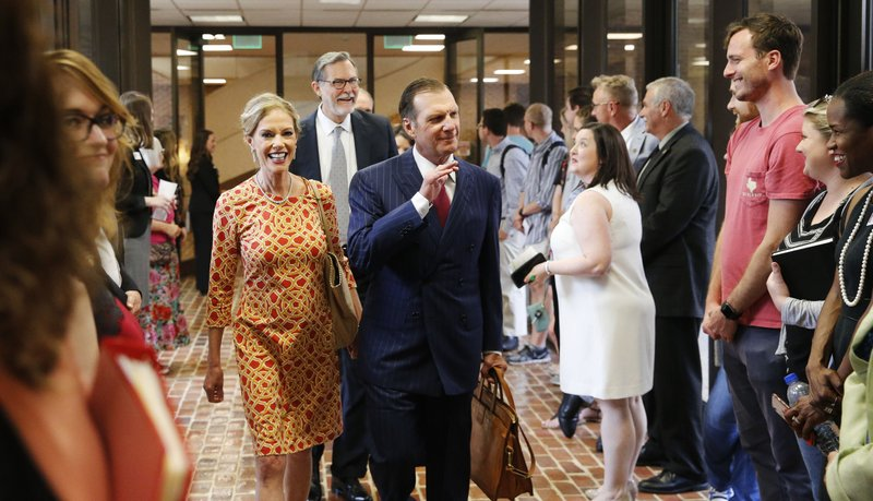 In this Sept. 20, 2018, photo, Hugh F. Culverhouse Jr. and his wife, Eliza, enter the University of Alabama law school in Tuscaloosa, Ala. The university appears poised to reject a $26.5 million pledge by Culverhouse, who recently called on students to boycott the university over the state's new abortion ban. (Gary Cosby Jr./The Tuscaloosa News via AP)
