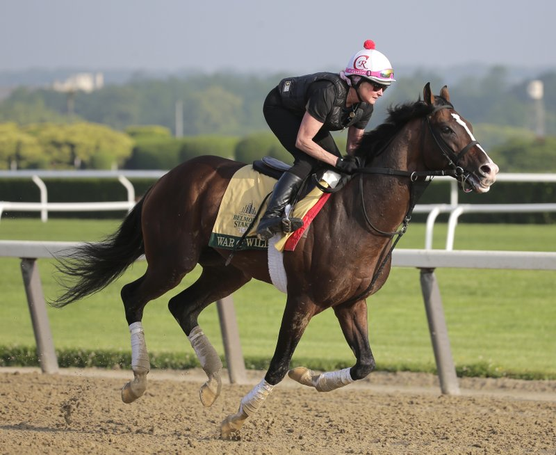 Exercise rider Kim Carroll rides War of Will during a workout at Belmont Park in Elmont, N.Y., Thursday, June 6, 2019. The 151st Belmont Stakes horse race will be run on Saturday, June 8, 2019. (AP Photo/Seth Wenig)
