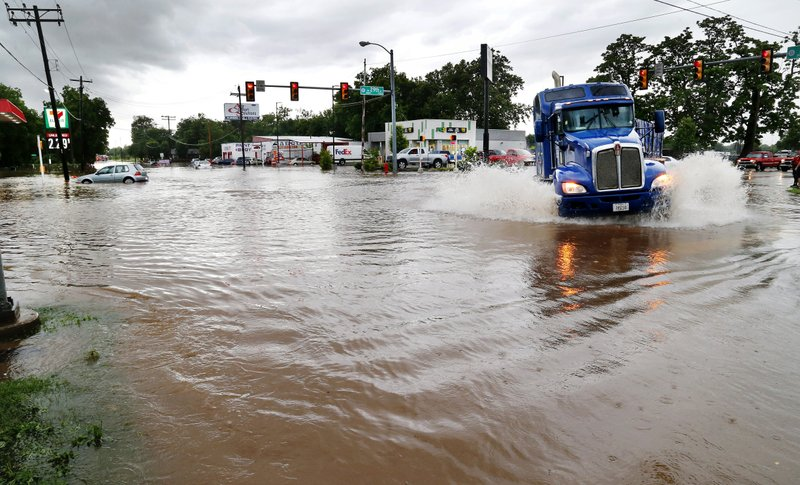 Heavy rains overwhelmed stormwater drainage systems and caused flooded streets, requiring high water rescues in Oklahoma City as another round of severe storms passes through the metro area Thursday, June 6, 2019, in the western part of the Oklahoma City area. City officials say around 600 Tulsa County homes and business were inundated during last week's historic flooding along the swollen Arkansas River. (Jim Beckel/The Oklahoman via AP)