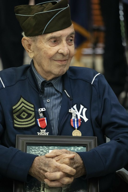 D-Day veteran Philip Di Marco, participates in a 75th anniversary ceremony at the Long Island State Veterans Home after receiving the New York State Conspicuous Service Cross, Thursday, June 6, 2019, in Stony Brook, N.Y. Di Marco was part of the First Wave of soldiers storming the beach at Normandy. (AP Photo/Mark Lennihan)