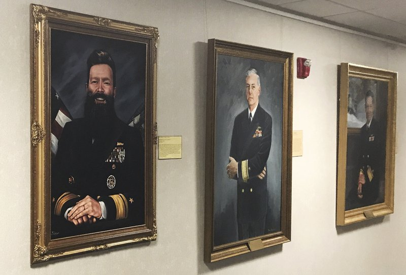 This May 2019 photo provided by U.S. Naval War College president Rear Adm. Jeffrey Harley, shows his official artist's portrait, left, displayed in a gallery in Conolly Hall on the school's campus in Newport, R.I. Dozens of emails, which span from December 2017 to May 2019, were shared with The Associated Press by people at the war college who said they were concerned about Rear Adm. Harley's leadership and judgment. (Rear Adm. Jeffrey Harley/U.S. Naval War College via AP)