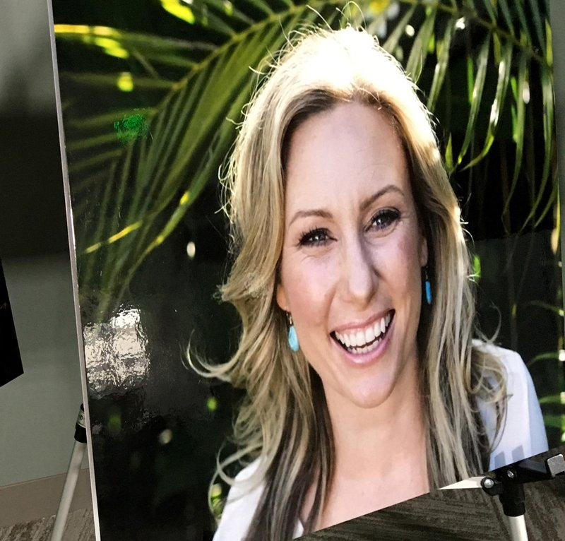 FILE - In this July 23, 2018, file photo, a poster of Justine Ruszczyk Damond is displayed at a news conference by attorneys for her family in Minneapolis. Attorneys for Mohamed Noor, a Minneapolis police officer convicted of murder in the shooting of Damond, an unarmed woman who had called 911, are asking a judge to give him a creative sentence rather than send him to prison. Noor's lawyers said in papers filed ahead of his Friday, June, 7, 2019, sentencing hearing that he should instead be required to report to county detention on Damond's birthday and the anniversary of her death. (AP Photo/Amy Forliti, File)