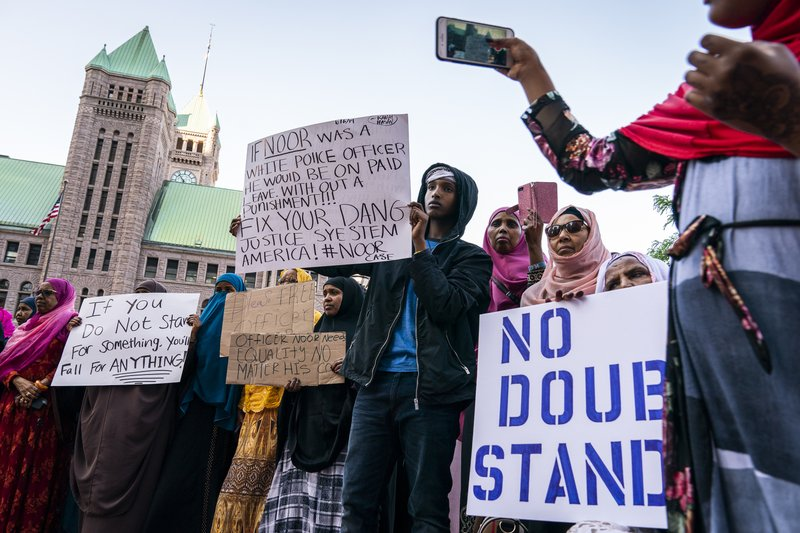 Somali-American supporters rally in support of former Minneapolis police officer Mohamed Noor on Thursday, June 6, 2019, in Minneapolis. Noor, convicted of murder in the shooting of an unarmed woman who had called 911, is scheduled to be sentenced Friday. (Leila Navidi/Star Tribune via AP)