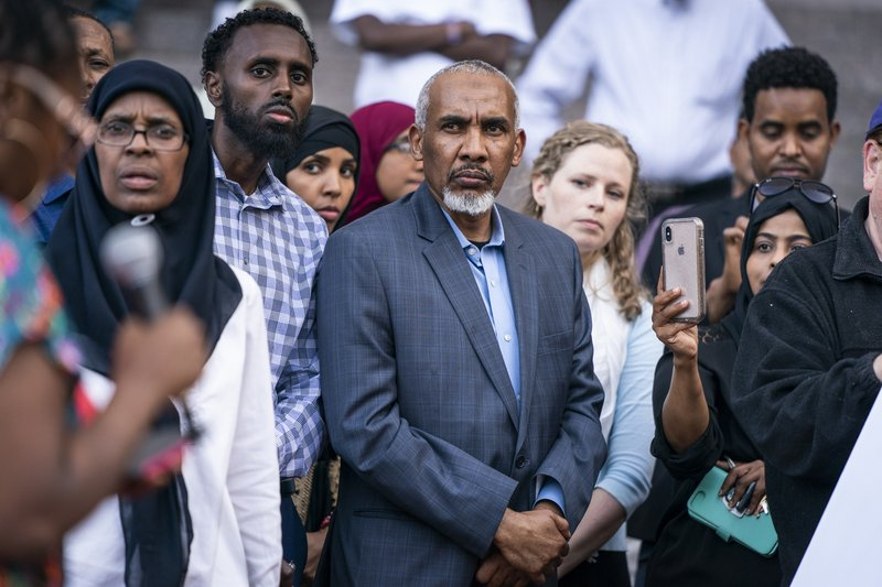 Mohamed Noor's father, Mohamed Abass, center, attends a rally in support of the former Minneapolis police officer Thursday, June 6, 2019, in Minneapolis. Mohamed Noor, convicted of murder in the shooting of an unarmed woman who had called 911, is scheduled to be sentenced Friday. (Leila Navidi/Star Tribune via AP)