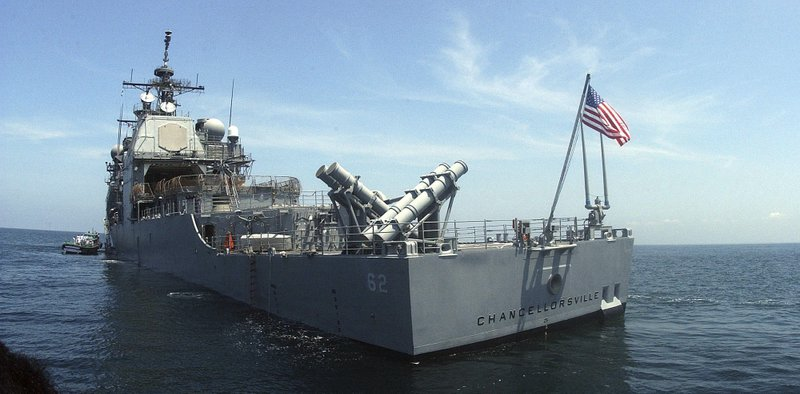 FILE - In this Sept. 27, 2002 file photo, the U.S. guided missile cruiser USS Chancellorsville lies at anchor in India's southern port of Cochin. The U.S. and Russian militaries accused each other of unsafe actions on Friday, June 7, 2019,  after the USS Chancellorsville and a Russian destroyer came within 165 feet (50 meters) of each other in the East China Sea. (AP Photo, File)