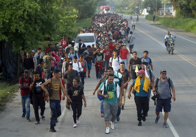Hundreds of Central American migrants walk on the highway, after crossing the Guatemala – Mexico border, near Ciudad Hidalgo, Mexico, Wednesday, June 5, 2019. State and local police provided a security escort to the migrants as they walked along a highway leading from the border to the first major city in Mexico, Tapachula. (AP Photo/Marco Ugarte)
