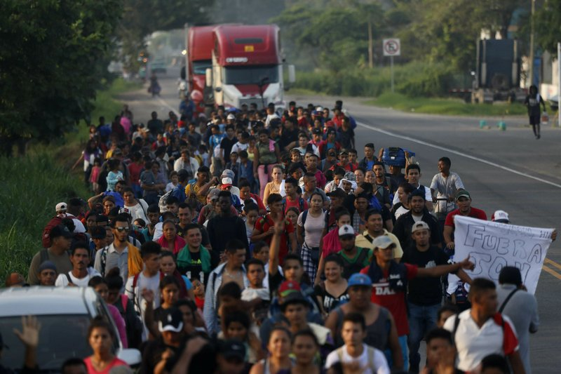 Hundreds of Central American migrants walk together on the highway, after crossing the Guatemala – Mexico border, near Ciudad Hidalgo, Mexico, Wednesday, June 5, 2019. (AP Photo/Marco Ugarte)