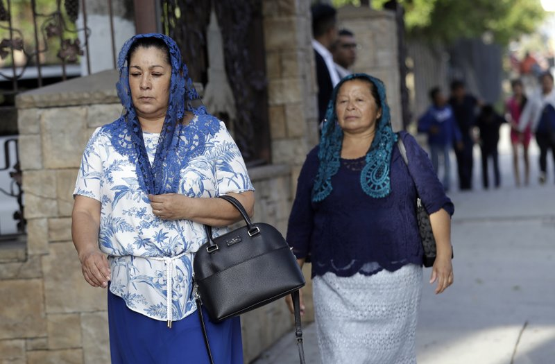 Worshipers arrive for a service at a La Luz del Mundo church branch Thursday, June 6, 2019, in Los Angeles. California's top prosecutor said Thursday that he believes there are more victims of child sex abuse than those listed in charges against the leader of Mexico-based megachurch La Luz del Mundo and several followers. (AP Photo/Marcio Jose Sanchez)