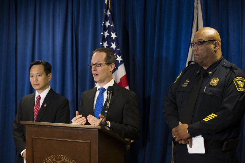 U.S. Attorney Benjamin C. Glassman, center, speaks during a press conference to discuss the investigation of a Cincinnati police captain who was arrested earlier this week. Federal authorities said Friday, June 7, 2019, that 52-year-old Michael Savard is accused of theft or bribery in a program receiving federal funds. He could face up to 10 years in prison if convicted. U.S. Attorney Benjamin Glassman says Savard tried to