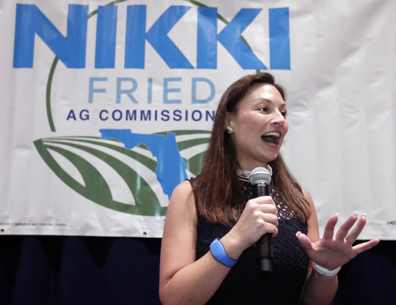 Nikki Fried, Florida's newly-elected Democrat commissioner of Agriculture and Consumer Services,  speaks at a reception during the Florida Democratic Party state conference, Friday, June 7, 2019, in Orlando, Fla. (AP Photo/John Raoux)