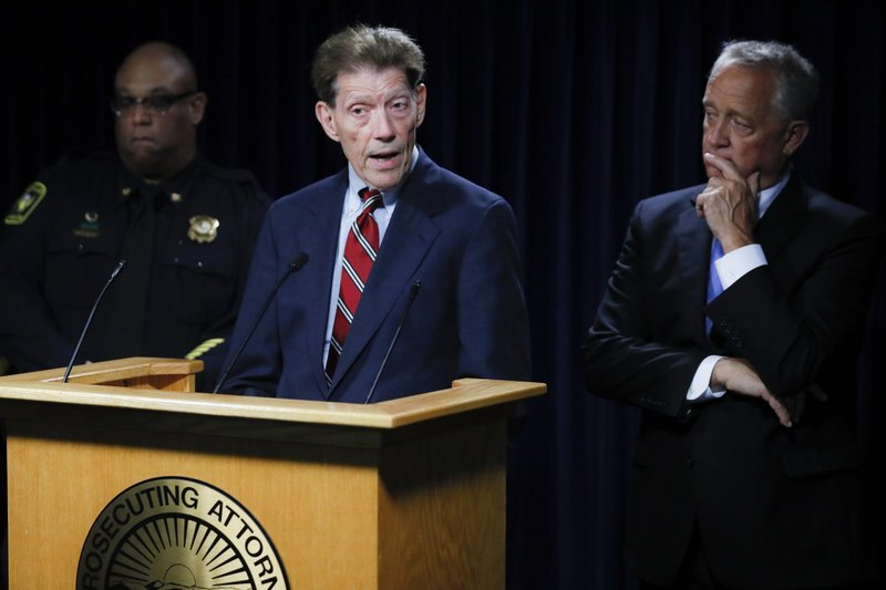Franklin County Prosecutor Ron O'Brien, center, speaks alongside Hamilton County Prosecutor Joseph Deters, right, and Cincinnati Police Chief Eliot Isaac, left, during a news conference to discuss cases linked to Samuel Little, Friday, June 7, 2019, in Columbus. Prosecutors have linked Little to the 1981 slaying of Anna Stewart, abducted in Cincinnati. Her body was dumped near Columbus. (AP Photo/John Minchillo)