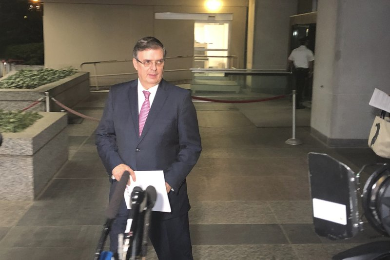 Mexican Foreign Minister Marcelo Ebrard gets ready to talk to reporters as he leaves the Department of State in Washington, on Friday June 7, 2019. President Donald Trump says he has suspended plans to impose tariffs on Mexico, tweeting that the country