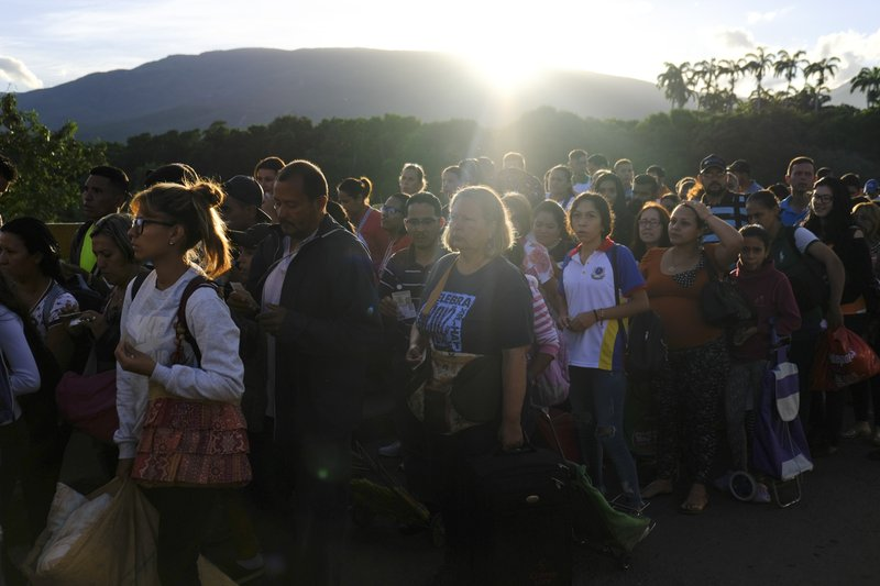 Venezuelans line up to cross the Simon Bolivar international bridge into Cucuta, Colombia, Saturday, June 8, 2019. Venezuela's President Nicolas Maduro ordered the partial re-opening of the border that has been closed since February when he stationed containers on the bridge to block an opposition plan to deliver humanitarian aid into the country. (AP Photo/Ferley Ospina)
