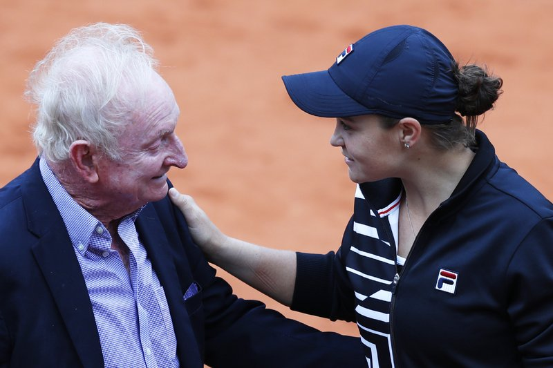 Australia's Ashleigh Barty, right, greets former Australian tennis ace Rod Laver after she defeated Marketa Vondrousova of the Czech Republic in the women's final match of the French Open tennis tournament at the Roland Garros stadium in Paris, Saturday, June 8, 2019. Barty won 6-1, 6-3. (AP Photo/Pavel Golovkin)