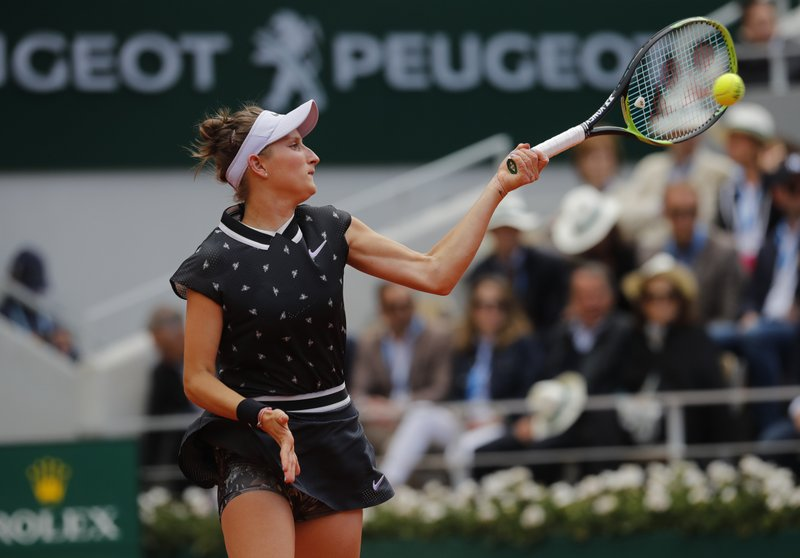 Marketa Vondrousova of the Czech Republic plays a shot against Australia's Ashleigh Barty during the women's final match of the French Open tennis tournament at the Roland Garros stadium in Paris, Saturday, June 8, 2019. (AP Photo/Michel Euler)