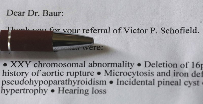 In this Thursday, June 6, 2019, photo, shows a 2015 letter concerning Victor P. Schofield from the Mayo Clinic at the home of Amie Schofield, in Ogden, Utah. (AP Photo/Rick Bowmer)
