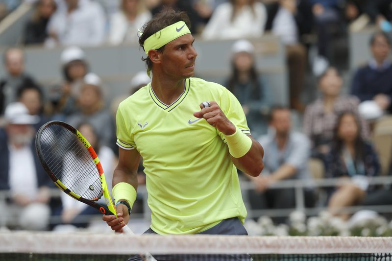 Spain's Rafael Nadal clenches his fist after scoring a point against Austria's Dominic Thiem during the men's final match of the French Open tennis tournament at the Roland Garros stadium in Paris, Sunday, June 9, 2019. (AP Photo/Michel Euler)