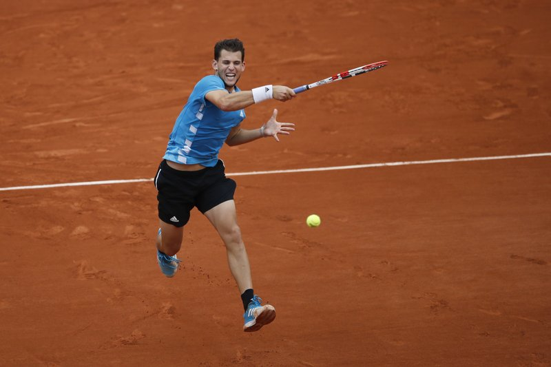 Austria's Dominic Thiem plays a shot against Spain's Rafael Nadal during the men's final match of the French Open tennis tournament at the Roland Garros stadium in Paris, Sunday, June 9, 2019. (AP Photo/Christophe Ena)