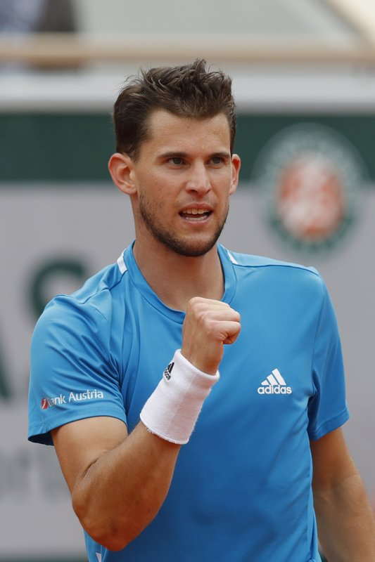 Austria's Dominic Thiem clenches his fist after scoring a point against Spain's Rafael Nadal during the men's final match of the French Open tennis tournament at the Roland Garros stadium in Paris, Sunday, June 9, 2019. (AP Photo/Michel Euler)