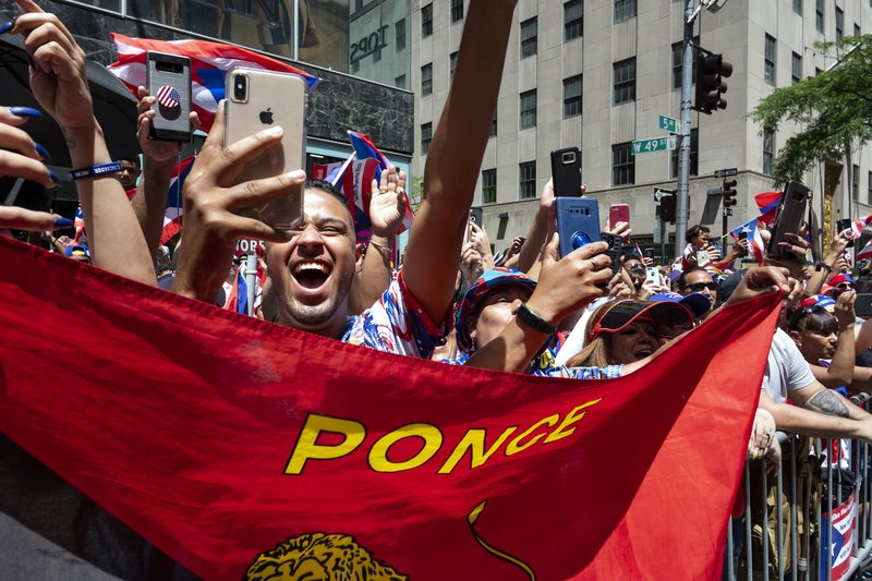 Spectators take part in the 62nd annual National Puerto Rican Day Parade Sunday, June 9, 2019, in New York. (AP Photo/Craig Ruttle)